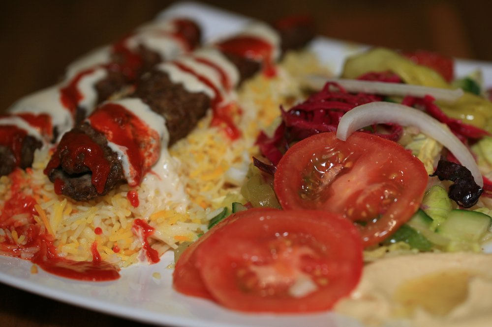 Beef Kabob on a platter with rice and veggies