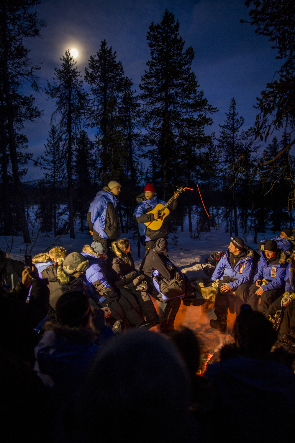 Björn Dixgård and Gustaf Norén of Mando Diao give Fjällräven Polar participants a surprise performance around the bonfire. (Photo by Håkan Wike for Fjällräven International. All rights reserved.)