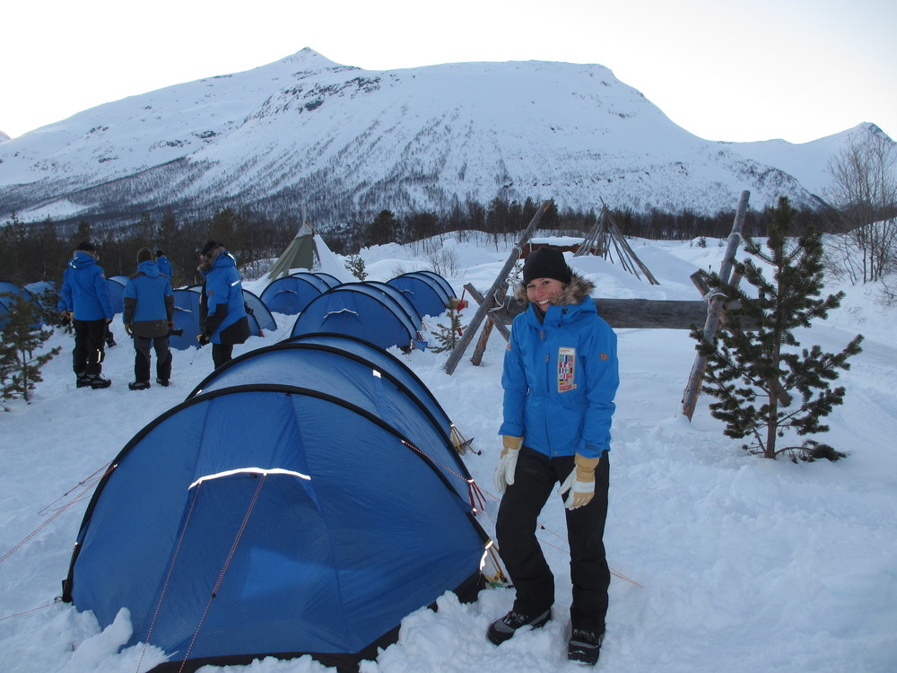 I pose with my first (somewhat) successfully erected tent at our practice campsite in the Tamok Valley on Day 2 of Fjällräven Polar. (Photo by Alex Kalita. All rights reserved.)