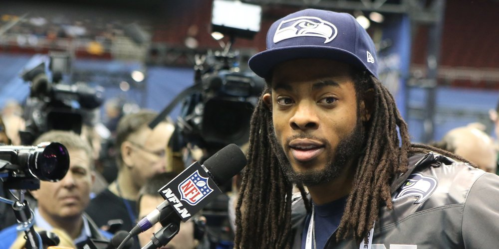 Richard Sherman looking hot as can be while being out of focus.jpg