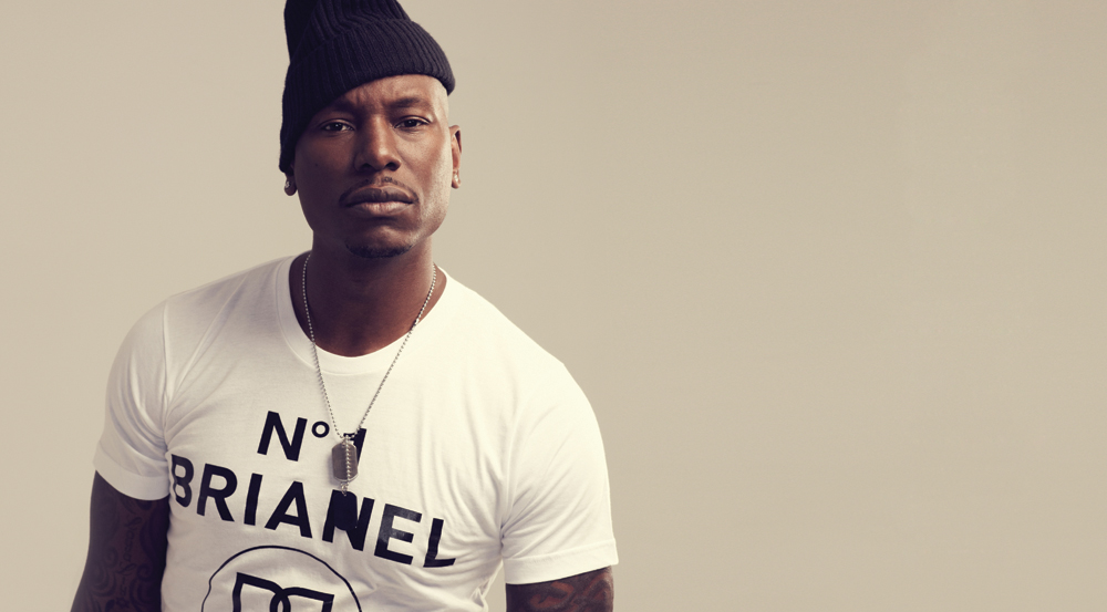 tyrese looking hot with a slim fit shirt and a knit cap.jpg