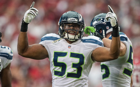 Malcolm Smith being hot on the field.jpg