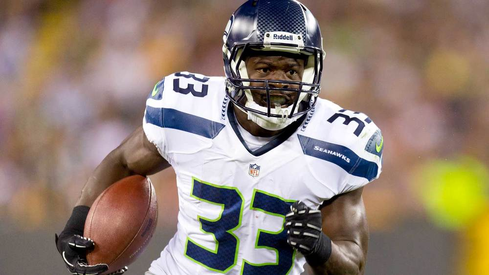 Christine Michael looking hot with the ball while wearing white.jpg