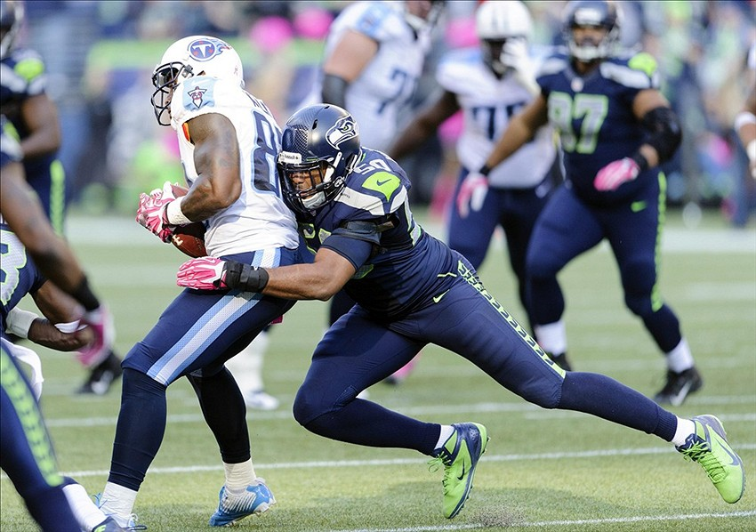K.J. Wright tackling someone unimportant.jpg