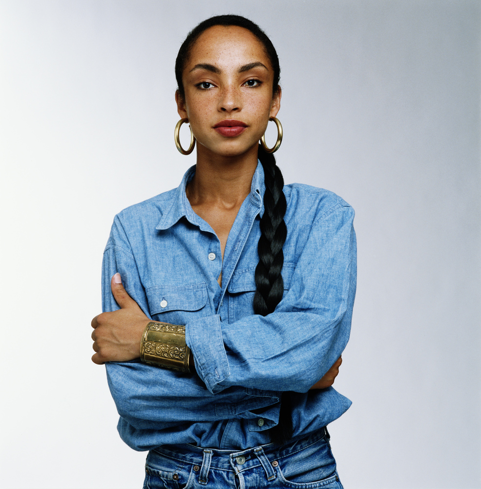 Sadé in a denim button down shirt.jpg