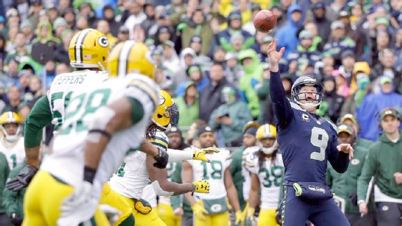 Jon Ryan throwing the ball to Garry Gilliam to complete a touchdown.jpg