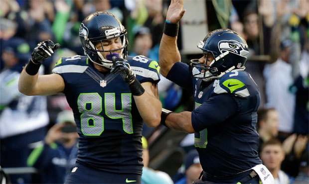 Cooper Helfet celebrating with gorgeous Russell Wilson.jpg