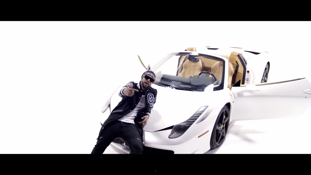 Omarion in the Post To Be video with the car.jpg