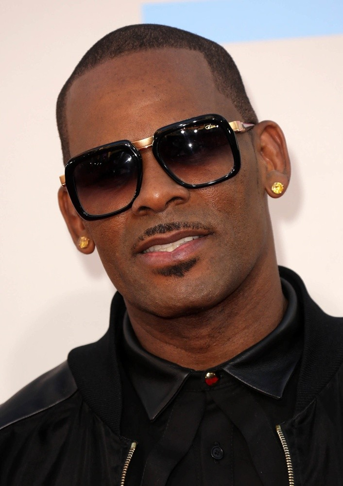 R. Kelly and his hot gold earrings.jpg