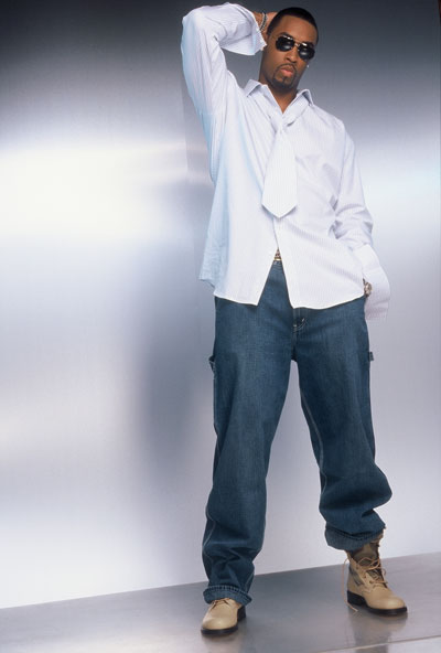 Montell Jordan looking hot in a white shirt and jeans.jpg