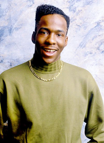 Bobby Brown looking hot in a green turtleneck.jpg