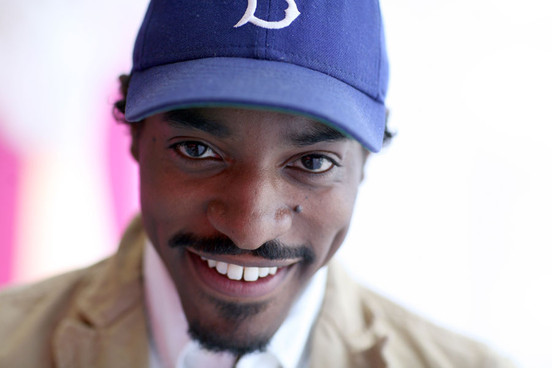 André 3000 looking really hot straight on with a baseball hat on.jpg