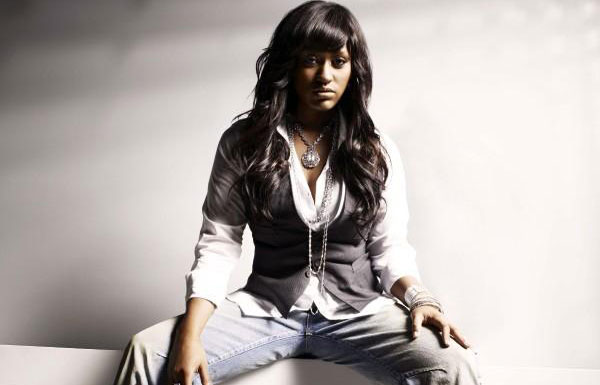 Jazmine Sullivan wearing jeans and sitting pretty.jpg