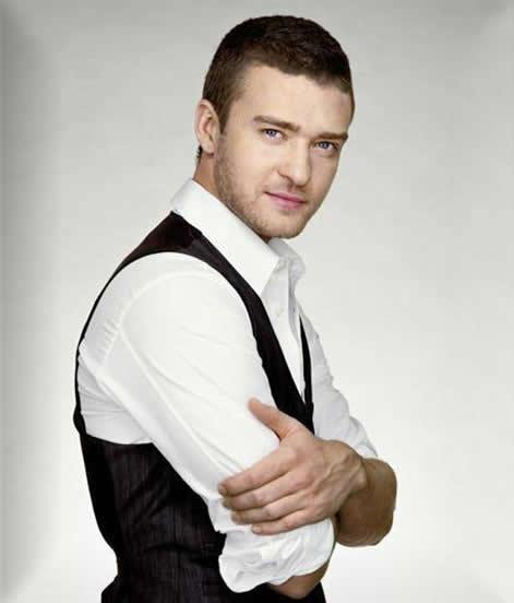 Justin Timberlake with a white collared shirt on in a pose you would get at JC Penney's portrait studios.jpg