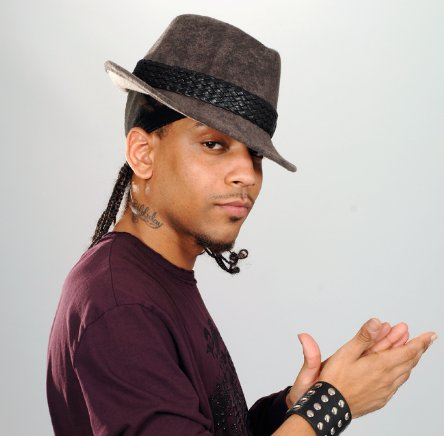 J. Holiday pulling off a fedora.jpg