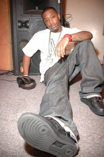 Mike Shorey sitting on the floor wearing Air Force Ones.jpg