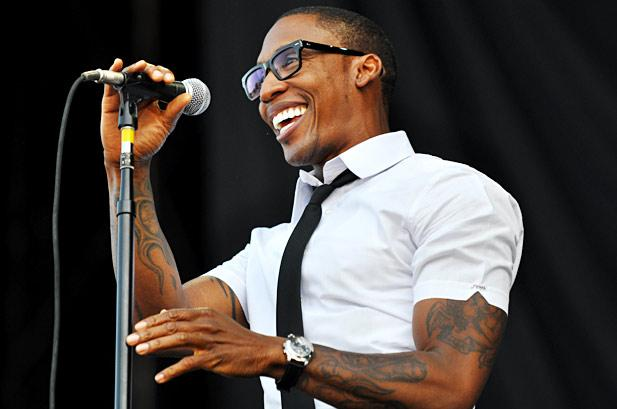 Raphael Saadiq smiling and looking gorgeous as ever.jpg