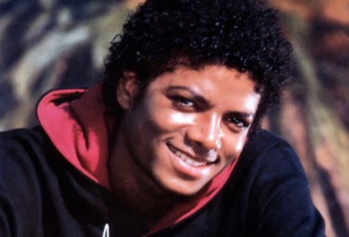 Michael Jackson wearing a hooded sweatshirt and smiling and looking hot.jpg