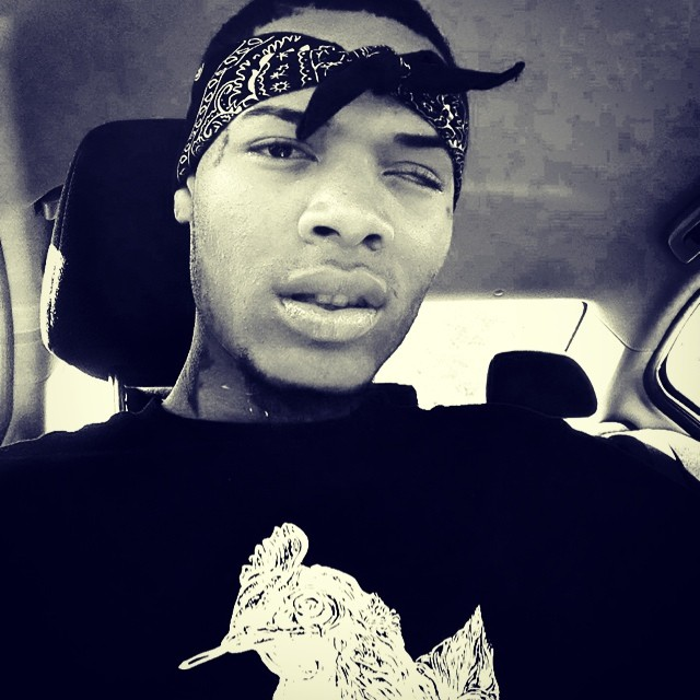 Fetty Wap sitting in his car taking a selfie.jpg