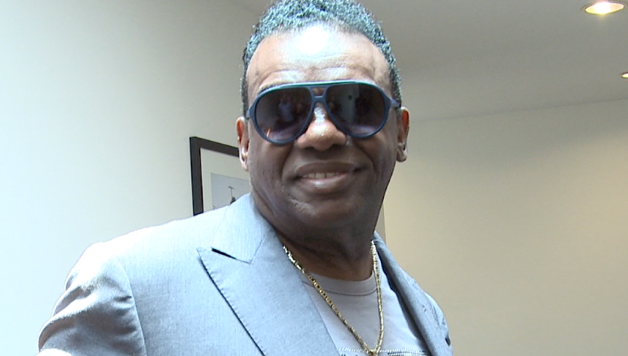 Ron Isley looking hot and smiling in a room.jpg