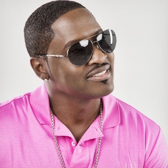 Johnny Gill looking hot in a pink polo shirt and sunglasses on.jpg