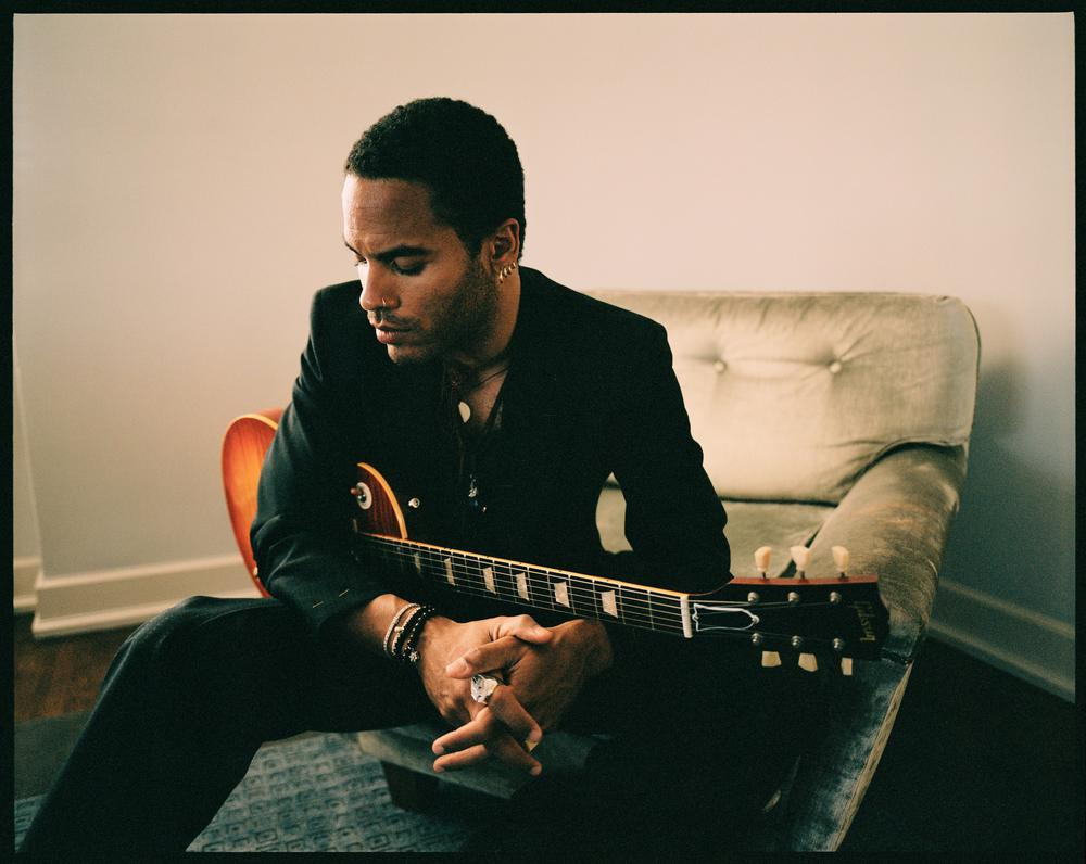 Lenny Kravitz looking extremely hot holding a guitar with short hair.jpg