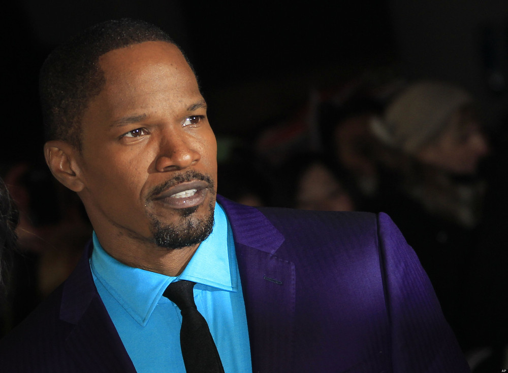 Jamie Foxx looking serious af in a purple and teal suit.jpg