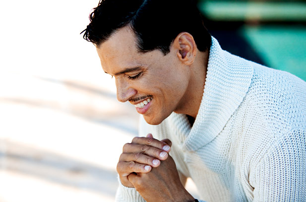El DeBarge in recent years looking down with his hot smile pouring out into the scene with a nice knit sweater on.jpg