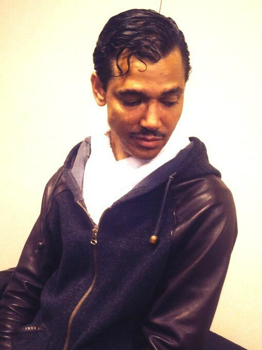 El DeBarge looking gorgeous with his hair fixed pretty and he's looking down looking hot.jpg