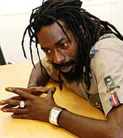 Buju Banton looking hot sitting at a desk.jpg