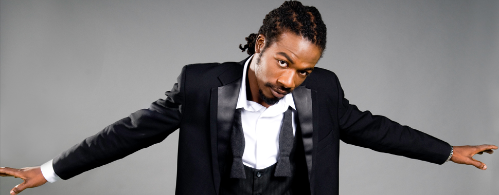 Gyptian with his arms wide open bc he's hot.jpg