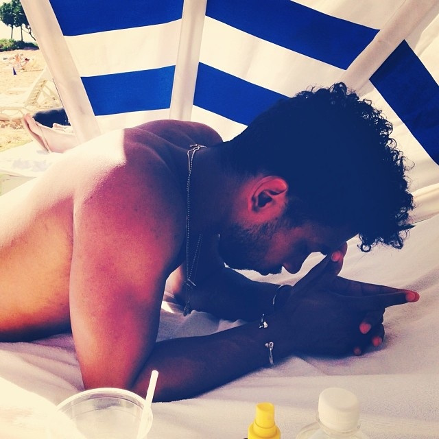 Miguel looking so hot under an umbrella at the beach with no shirt on omg.jpg