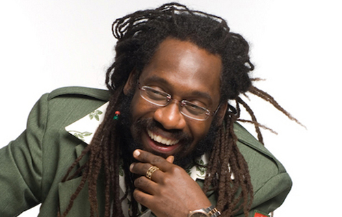 Tarrus Riley looking hot smiling with a bead in his hair.jpg