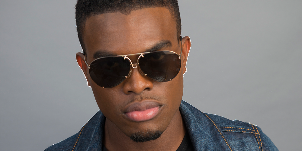 a close up on OMI's hot face with sunglasses on- he's gorgeous.jpg