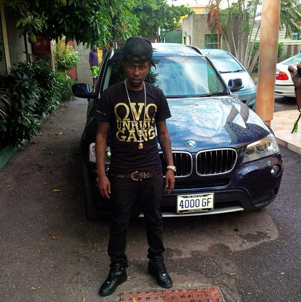 Popcaan looking really hot in front of a BMW.jpg