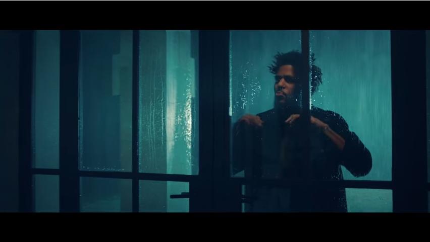 J. Cole outside the window in No Sleeep looking hot.jpg