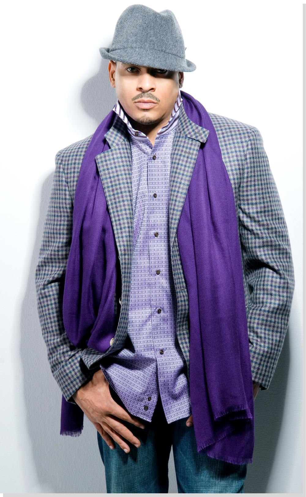 Christopher Williams wearing a casual suit and wearing purple.jpg