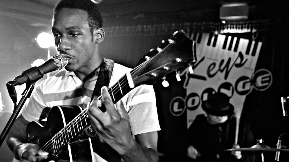 Leon Bridges on stage wearing regular clothes looking hot.jpg
