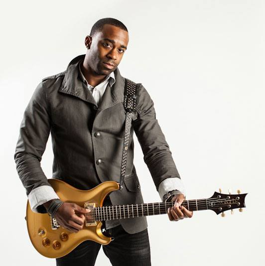 Curt Chambers posing with his guitar during a photoshoot.jpg