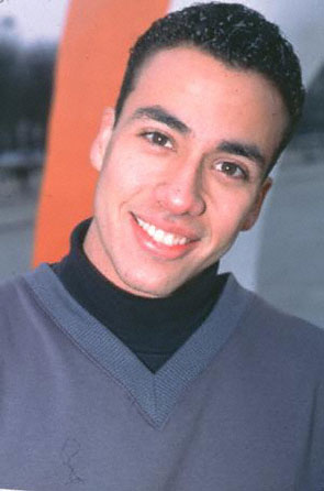 Howie D smiling and looking hot in a turtle neck.jpg