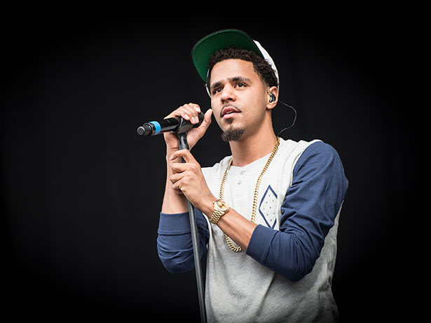 J. Cole looking hot in a nice shirt as he holds the microphone.jpg