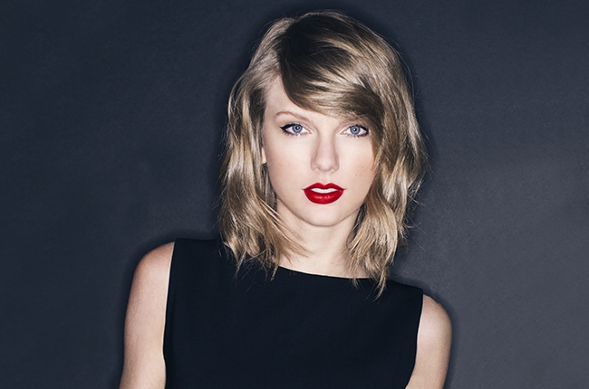 Taylor Swift looking pasty af because she's artificial.jpg