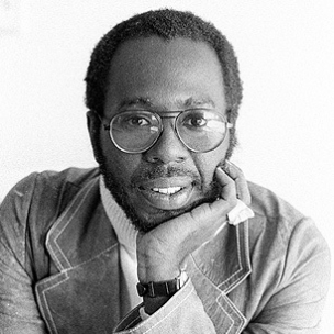 Curtis Mayfield wearing a blazer and smiling.jpg