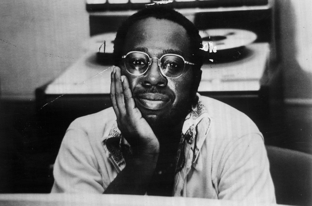 Curtis Mayfield with his hand upon his face smiling and looking like an angel.jpg