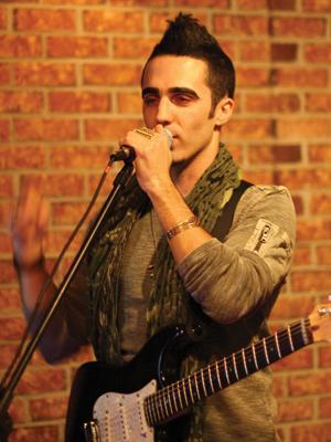 Dru Decaro singing into the microphone.jpg