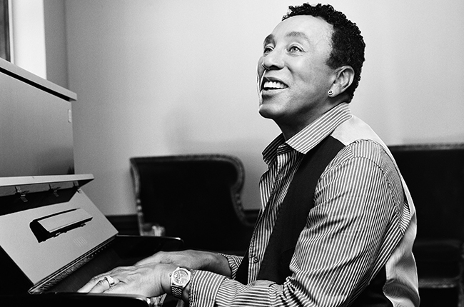 Smokey Robinson looking hot as he plays the piano.jpg