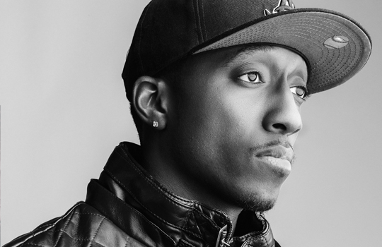 a greyscale photo of Lecrae looking hot.jpg