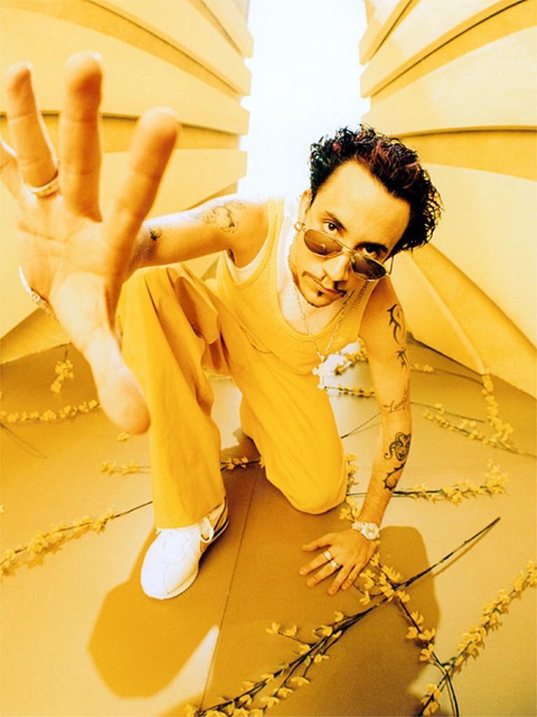 AJ McLean in all yellow for the Millennium album.jpg