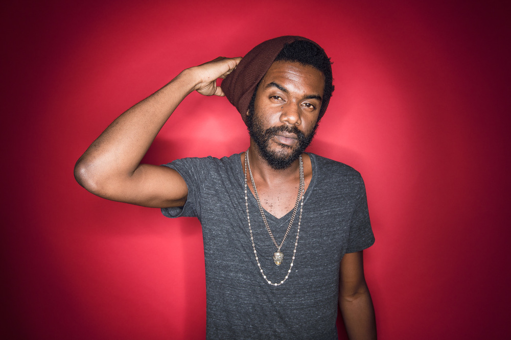Gary Clark, Jr. looking gorgeous behind a red backdrop.jpg