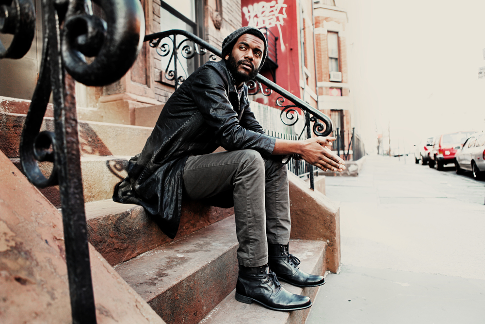 Gary Clark, Jr. sitting outside on the steps looking hot.jpg